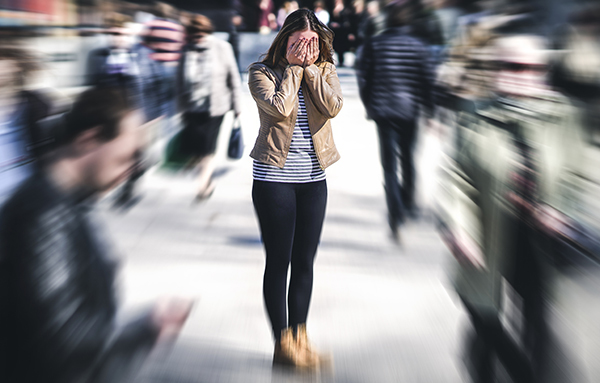 woman-standing-in-street-stressed.jpg