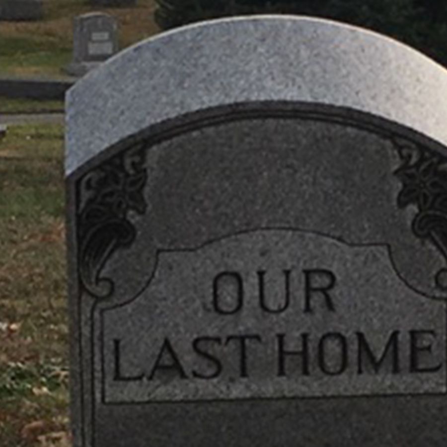 a grave stone reading our last home