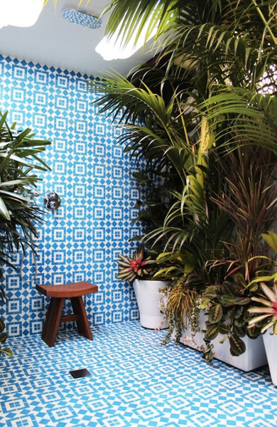 Outdoor-shower-covered-with-plants-and-granite-flooring-and-wall.jpg