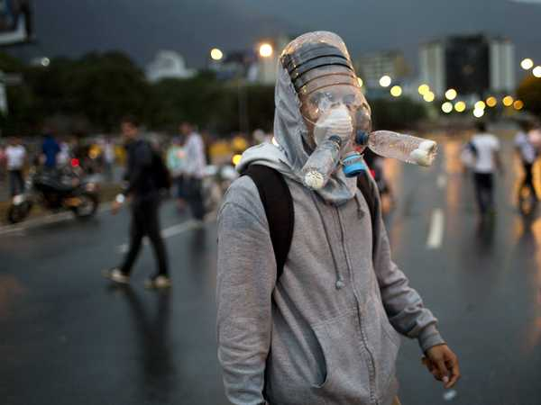 protesters-in-venezuela-are-wearing-crazy-looking-homemade-gas-masks.jpg